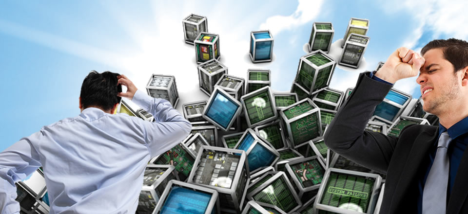 Image of confused technician in front of a pile of computer devices to depict need for IT Solutions and IT Support in Grand Rapids and West Michigan from Micro Visions Inc.