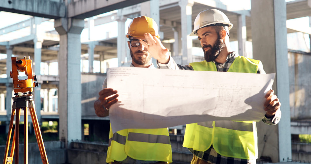 Two construction employees discuss Efficiency on their current construction project.